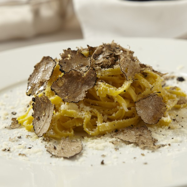 Handmade 40 organic egg yolks taglioline with Umbria fresh black truffles